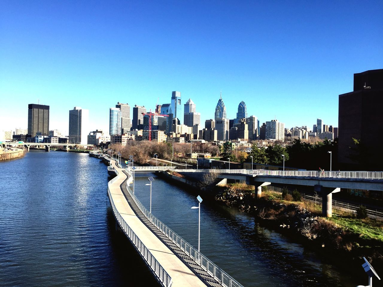Schuylkill River In City Against Clear Sky