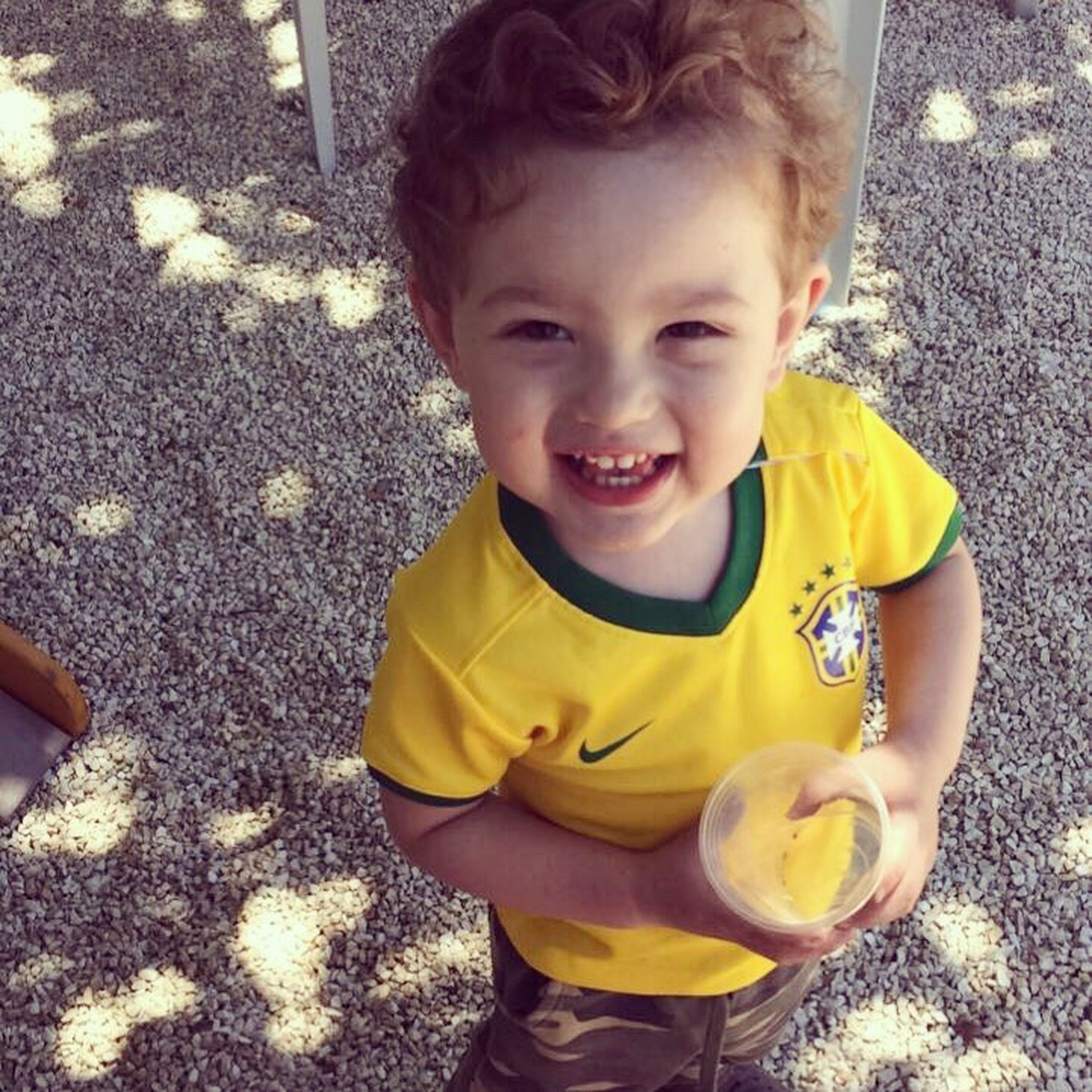 childhood, innocence, portrait, looking at camera, one person, yellow, happiness, outdoors, smiling, food, playing, real people, day, people, close-up, cheerful