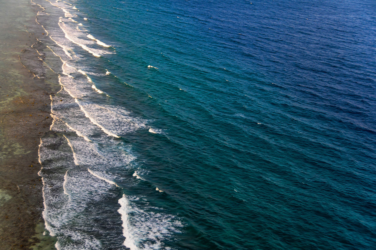Aerial view to ocean surf at coral island in Maldives Aerial Photography Aerial View Day High Angle View Ma;dives Nature No People Ocean Ocean Surf Outdoors Sea Travel Destinations Travel Photography Water Wave