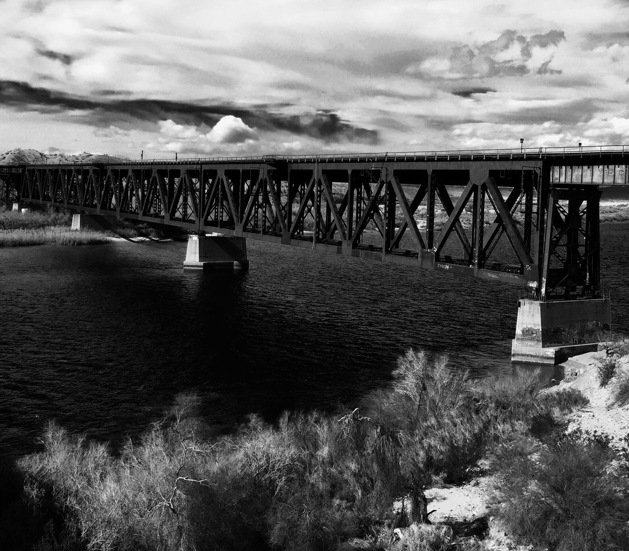 Johnny cash sang, I hear the train a comin' It's rollin' 'round the bend Train Track Train Trestle Bridge Trainphotography Trains_worldwide Trains And Railroads Train Rails Train Bridge Train Sky Clouds river River