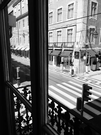 Através da vidraça Calçada Portuguesa Portuguese Architecture Lisbonlovers LisbonLight Urbanphotography Urban Photography Natural Light Black & White Traffic Lights Old Town Crosswalk Urban Geometry Afternoon Sun Capital City Old Buildings Not Forgotten Blackandwhite Photography Arquitecture Lisbon Lounge Hostel Get To Know Your Country Travel Like A Tourist