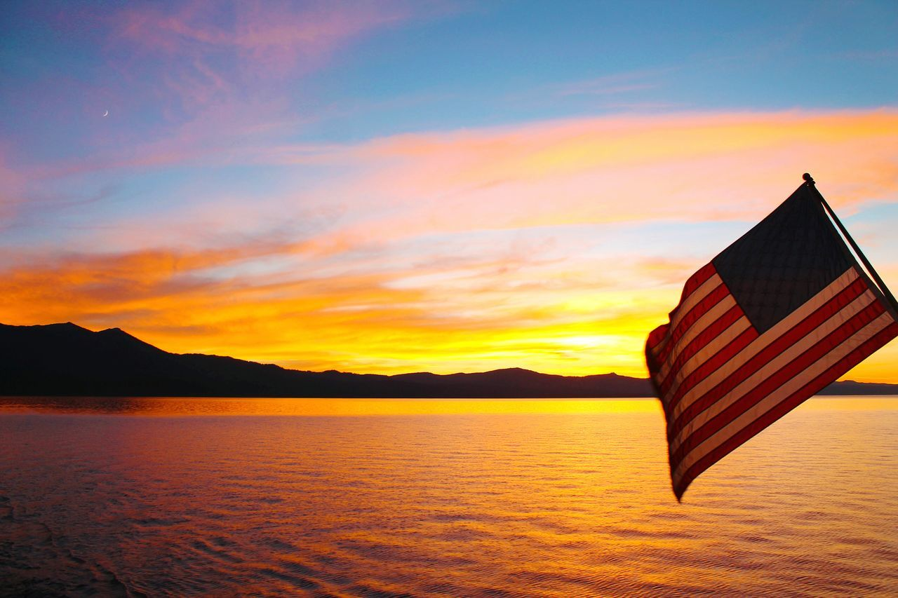 Lake Tahoe American pride. American Flag Flag USA Lake Tahoe Water Boat Lake California Sunset Mountains