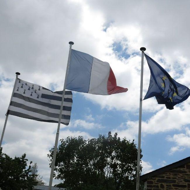 "Flags of Bretagne (called ""Gwen ha du"" in Brezhoneg ), France and the EU in Taupont Breizh Morbihan"