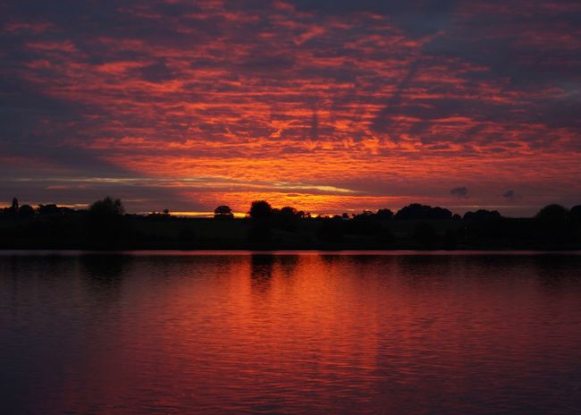 Sunset Nature Beauty In Nature Sky Reflection Scenics Water Tranquil Scene Tranquility Silhouette Cloud - Sky Lake Idyllic No People Dramatic Sky Outdoors Dramatic Sky Dramatic Mere Cheshire Trees Trees And Sky Red Sky Natural