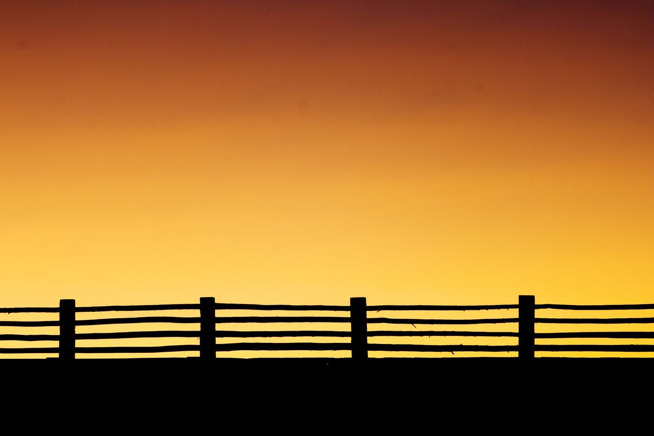 Silhouette Of Railing Against Clear Sky During Sunset