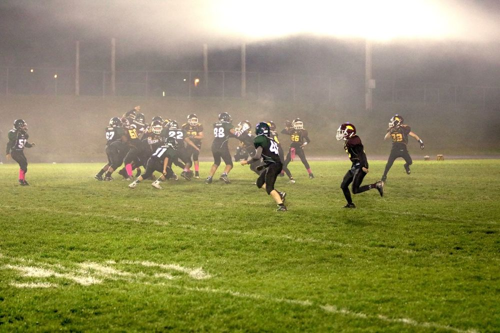 American Football Team Children Competition Competitive Sport Outdoors Playing Field Real People Sport Sports Clothing Sports Helmet Sports Team Team Sport Teamwork