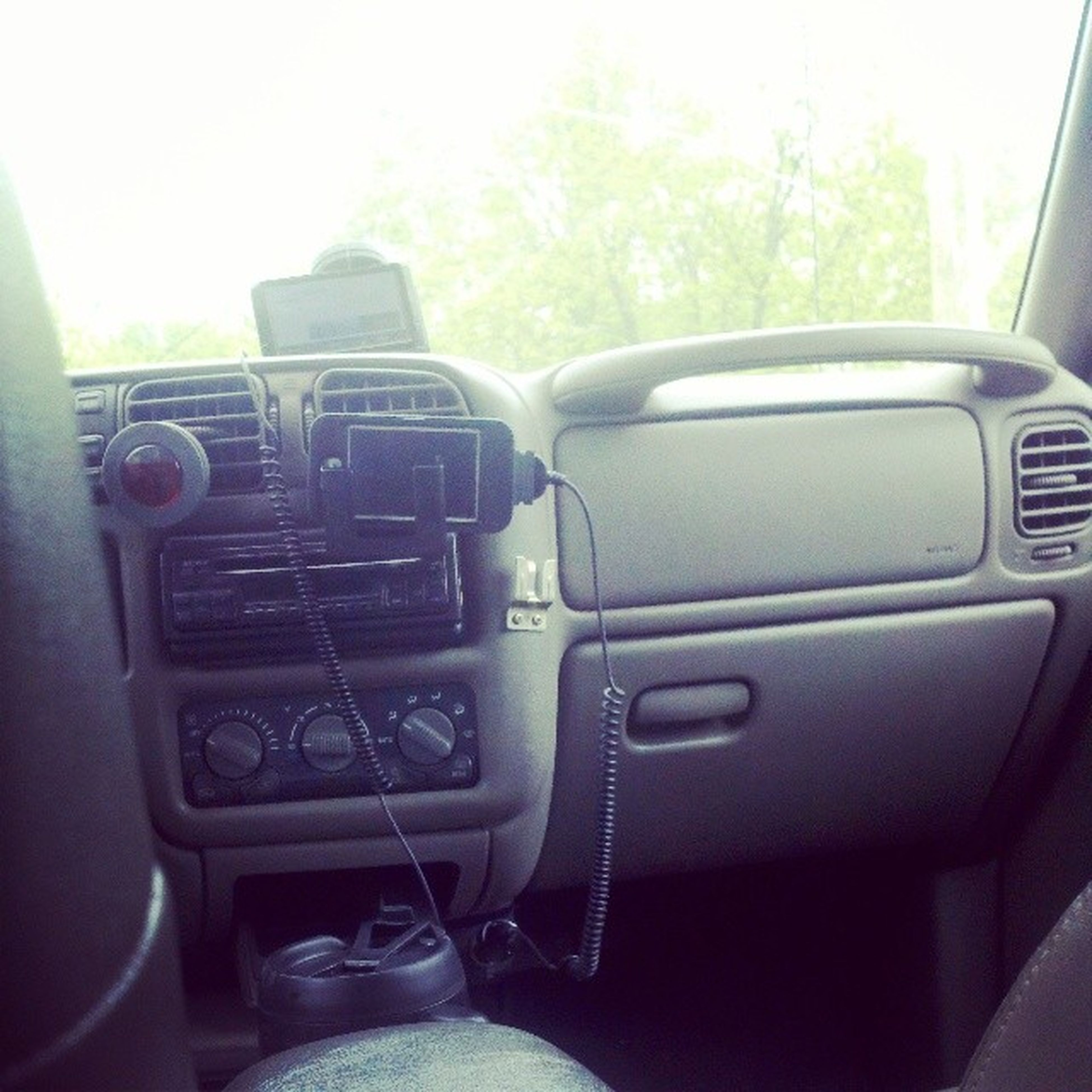 transportation, mode of transport, car, land vehicle, vehicle interior, travel, car interior, close-up, day, vehicle seat, vehicle, steering wheel, stationary, technology, no people, part of, journey, windshield, sunlight, indoors
