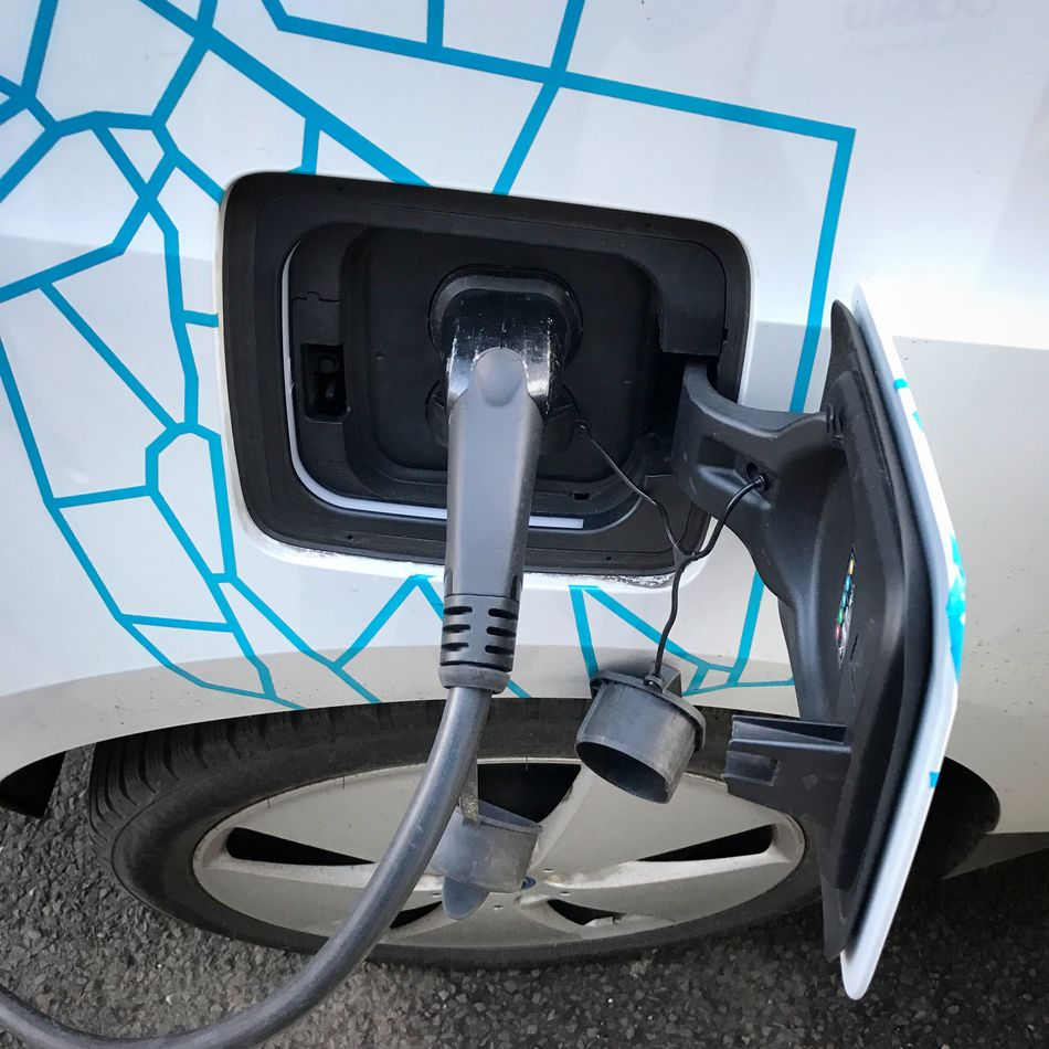 Technology No People Close-up Body Care Indoors  Day Charging an electric car Car Cars Electric Car Electric Vehicle Electric Vehicle Charging Station Charging Electric Car Charging Charging Station Electricity  Green Environmental Issues Environment Zero Emission