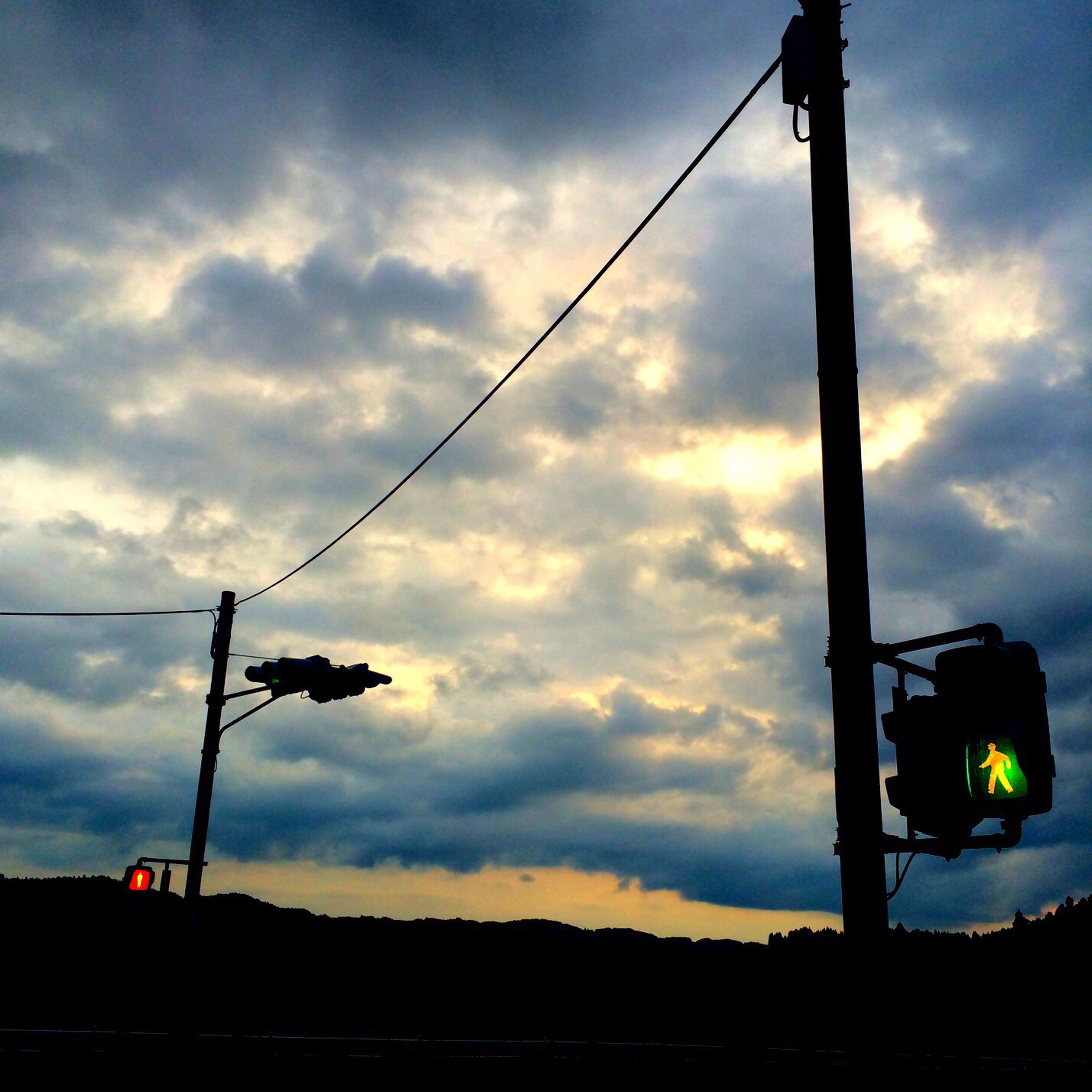 sky, silhouette, low angle view, cloud - sky, street light, sunset, lighting equipment, transportation, power line, electricity, cable, dusk, cloudy, cloud, technology, pole, mode of transport, illuminated, power supply, outdoors