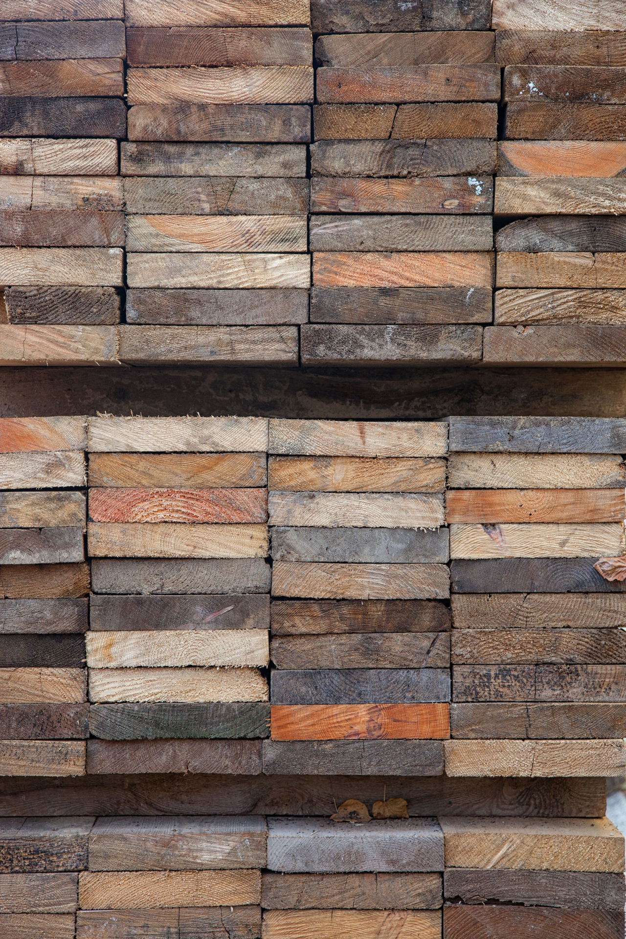 Structures and Backgrounds as found in Berlin: Stack of Wooden planks Backgrounds Boards Details Details Textures And Shapes Grunge Many Planks Run-down Stack Stacked Structures Textured  Textures Textures And Surfaces Vertical Wood Wood - Material Wooden Wooden Texture