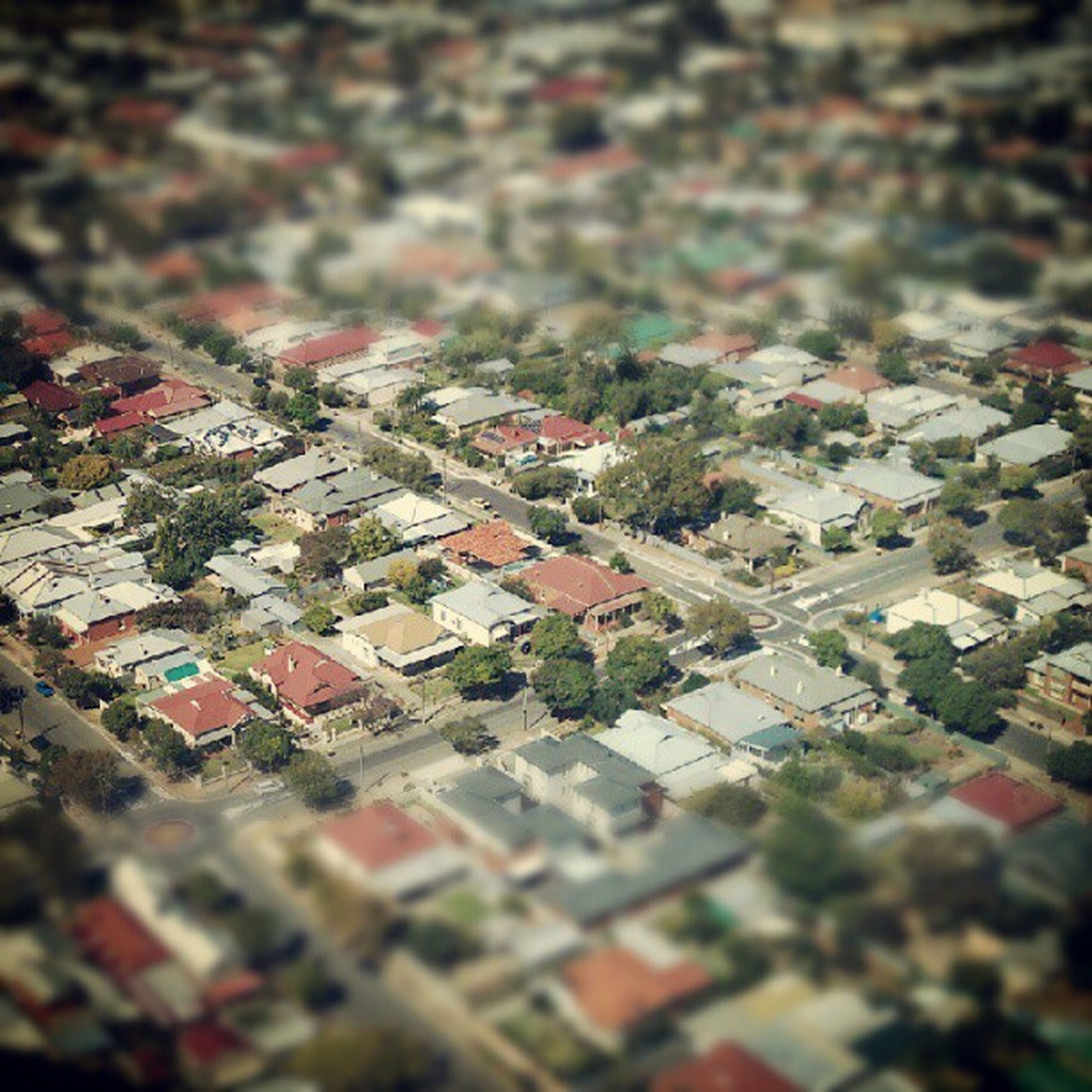 building exterior, architecture, built structure, crowded, high angle view, residential district, city, cityscape, residential structure, residential building, roof, selective focus, house, town, day, townscape, outdoors, street, aerial view, no people