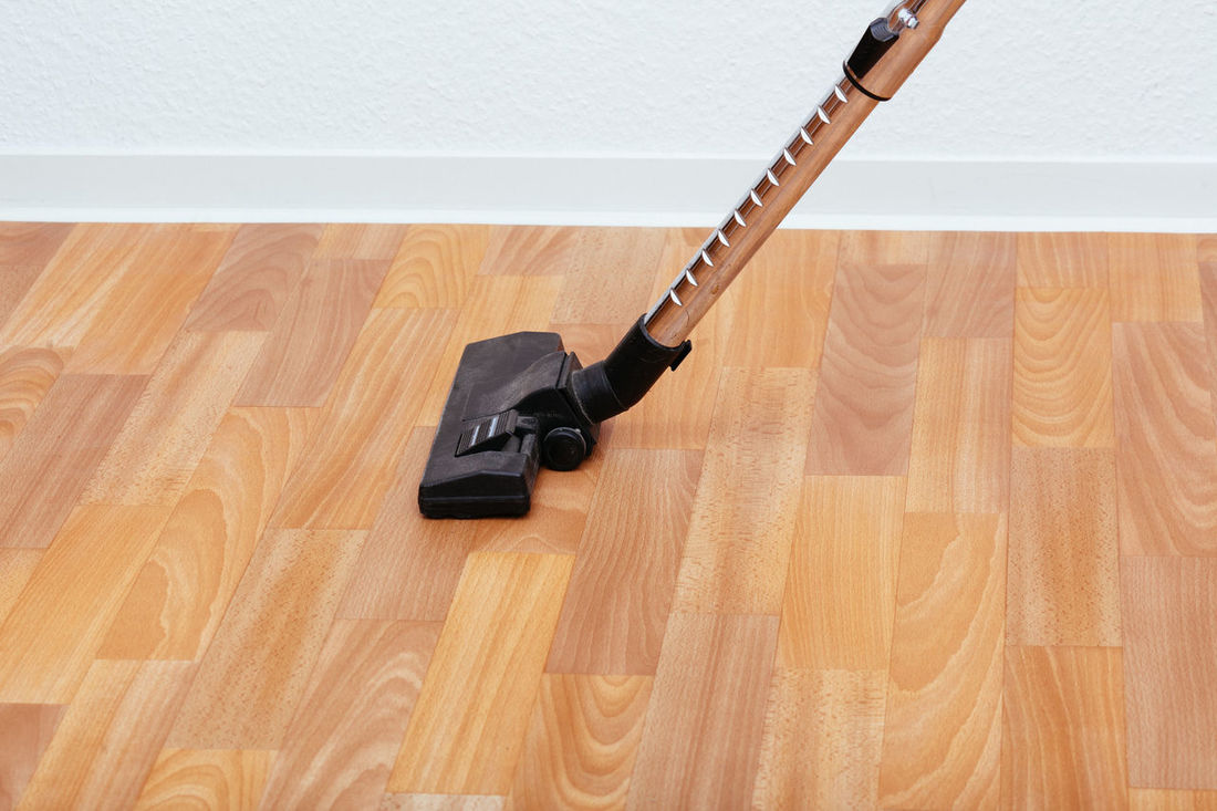 Closeup to vacuum cleaner on floor, studio indoors shot Activitiy Appliance Cleaning Floor Hoover Household Life Living Male Man Person Real People Real Person Using Vacuum Cleaner Wall
