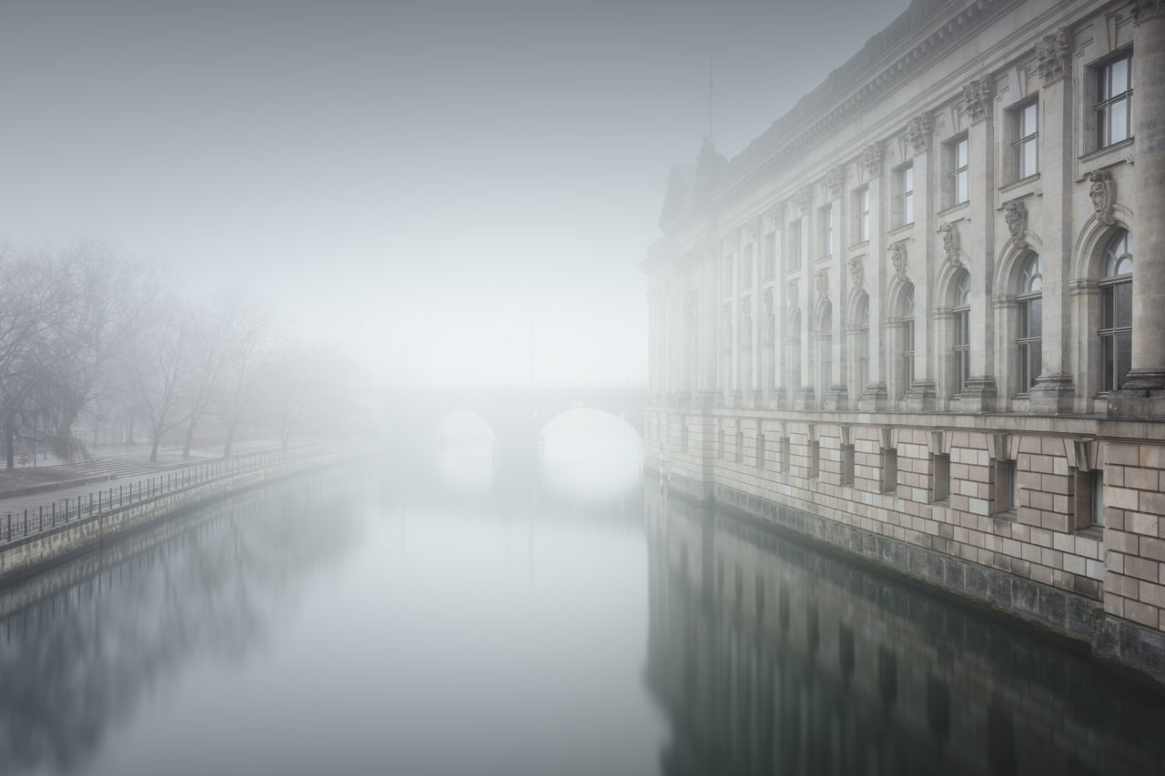reflection of the bodemuseum in water on a foggy day Architecture Architecture Berlin Berlin Mitte Bodemuseum Bridge - Man Made Structure Built Structure City Day Fine Art Foggy Day Germany Long Exposure Misty Day Muted Colors Nature No People Outdoors Philipp Dase Sightseeing Sky Spree River Berlin Travel Destination Urban Icon Water