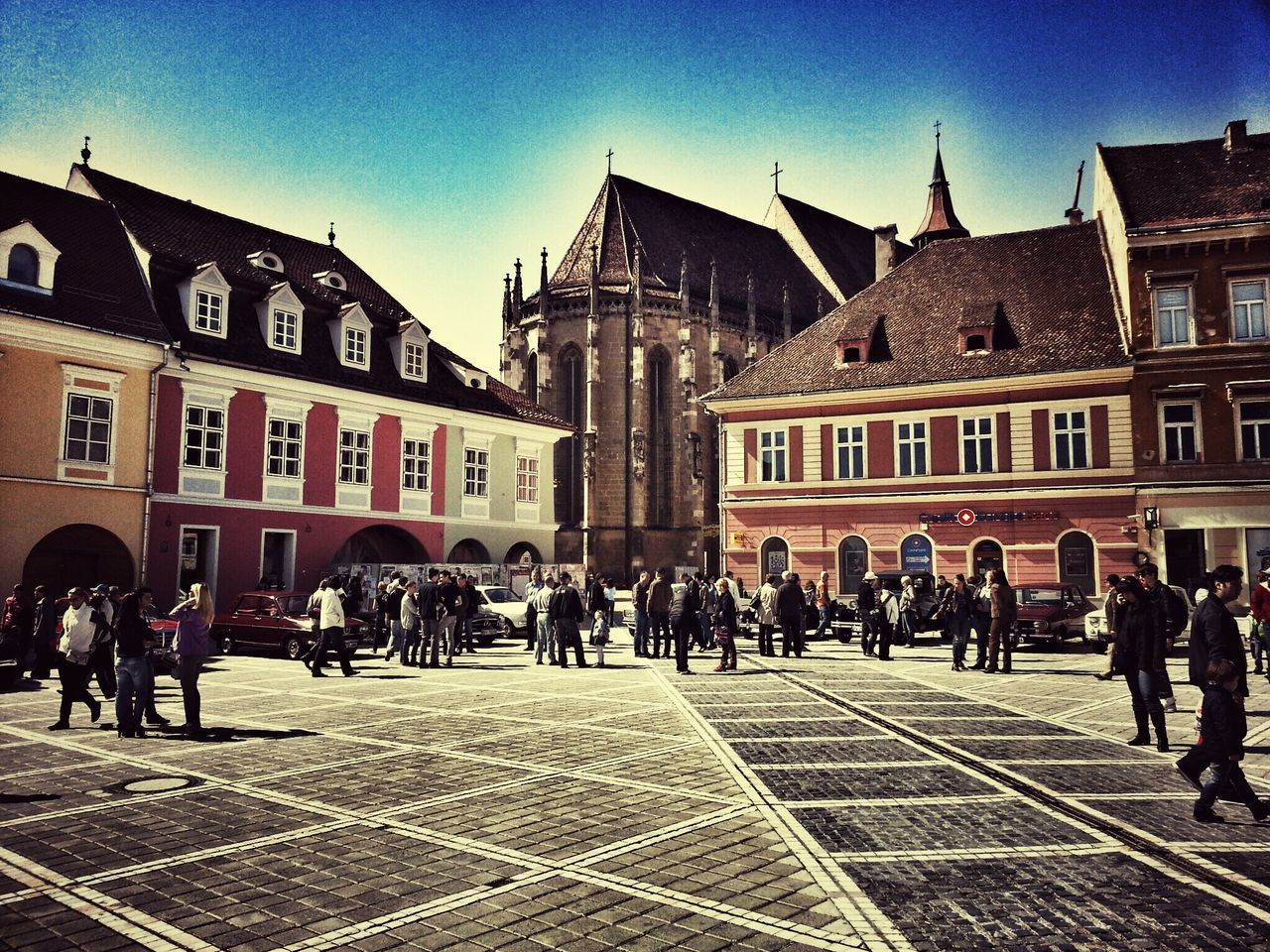 architecture, large group of people, building exterior, built structure, outdoors, day, real people, men, sky, city, people