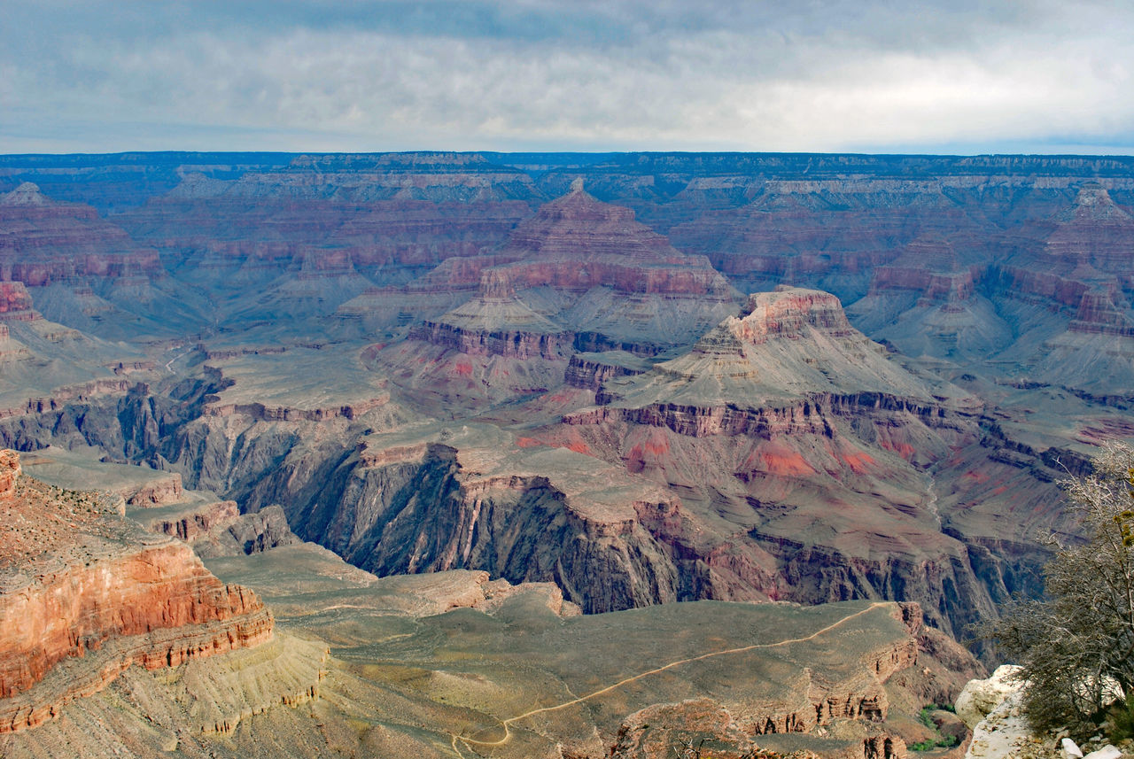 Aerial View Of Canyon Against Cloudy Sky