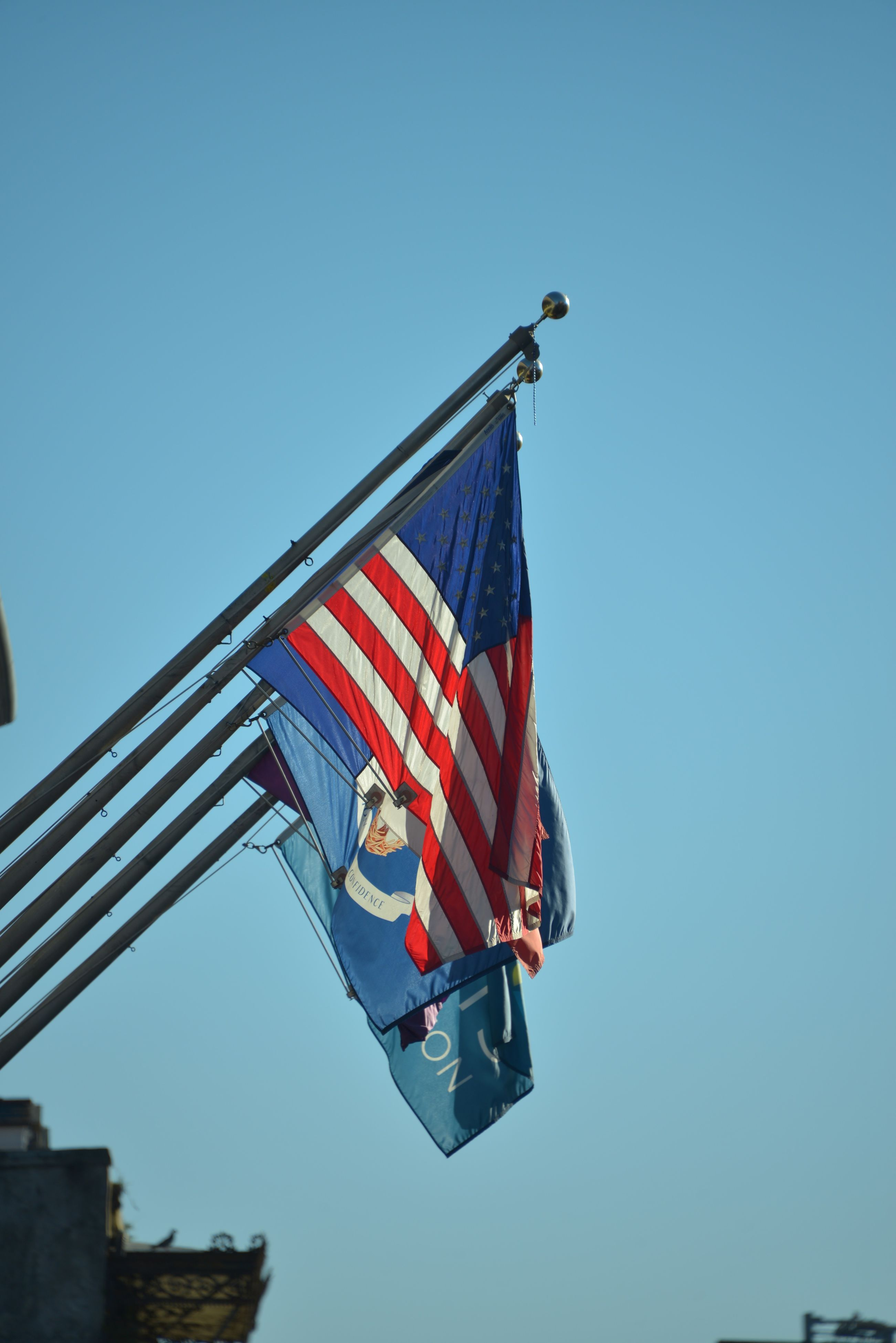 flag, patriotism, low angle view, blue, clear sky, day, no people, red, outdoors, stars and stripes, sky