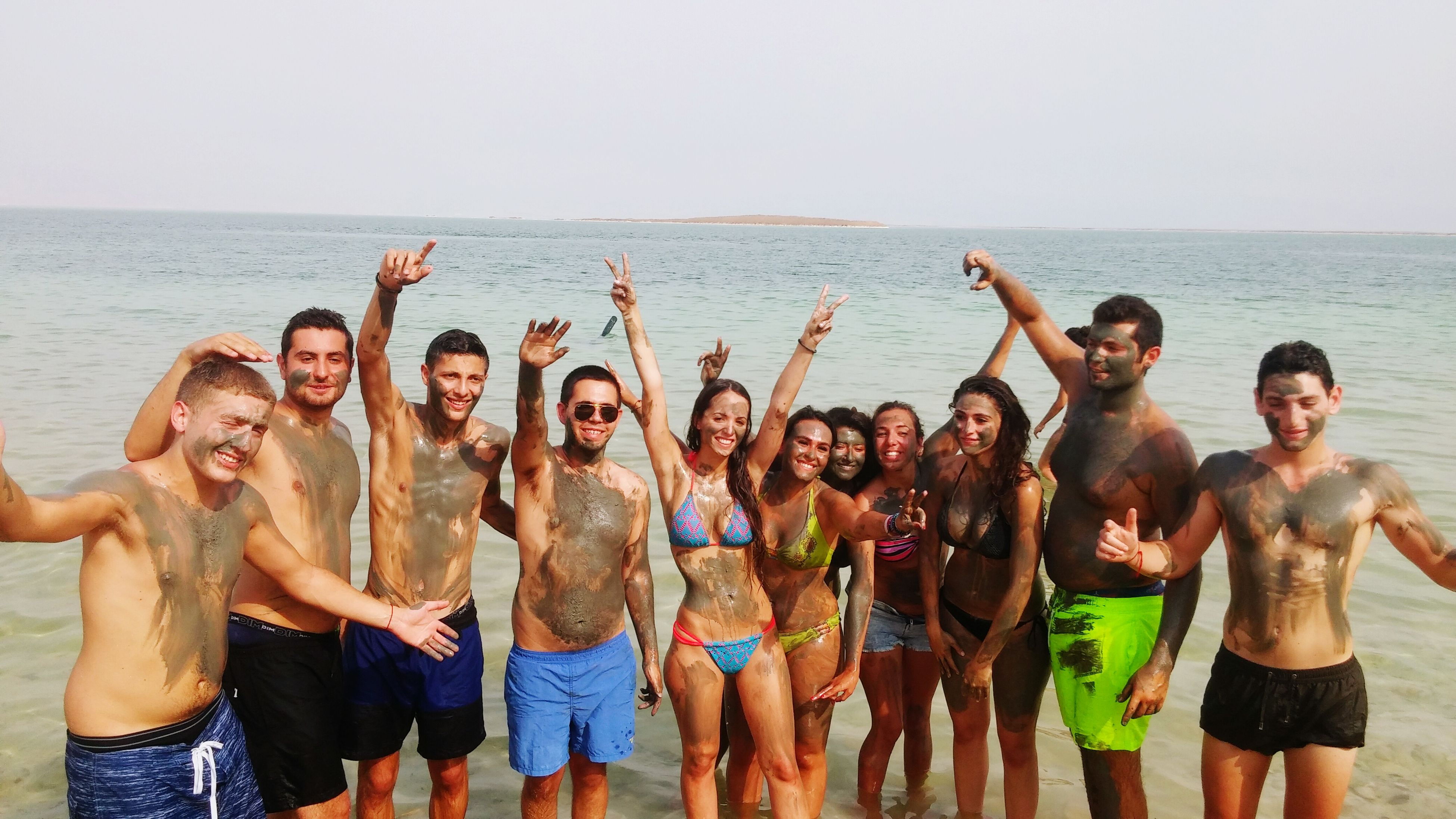togetherness, lifestyles, leisure activity, men, sea, bonding, person, water, friendship, standing, clear sky, love, beach, enjoyment, copy space, large group of people, vacations, fun, horizon over water