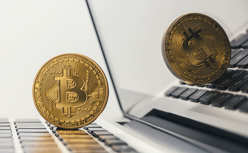 golden bitcoin on a notebook Anonymous Business Crash Currency Gold Reflection Trading Virtual Banking Bit-coin Bitcoin Bubble Coin Concept Concept; Crypto Cryptography Display Finance Internet Keyboard Litecoin Mining Money Pay