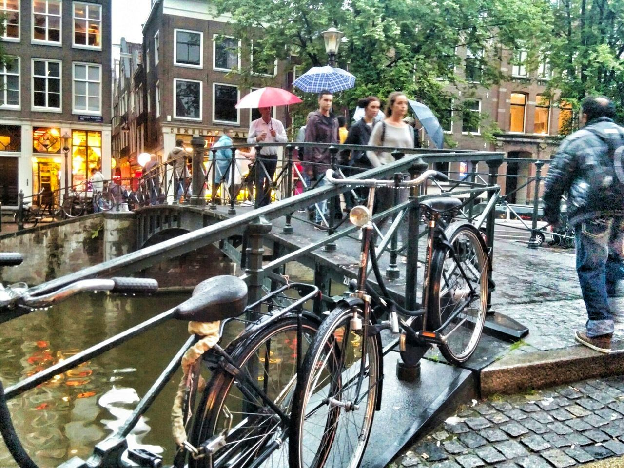bicycle, city, outdoors, city life, cycling, building exterior, women, day, people, men, adult, group of people, transportation, full length, built structure, architecture, adults only, tree, lifestyles, standing, real people, togetherness, large group of people, young women, young adult