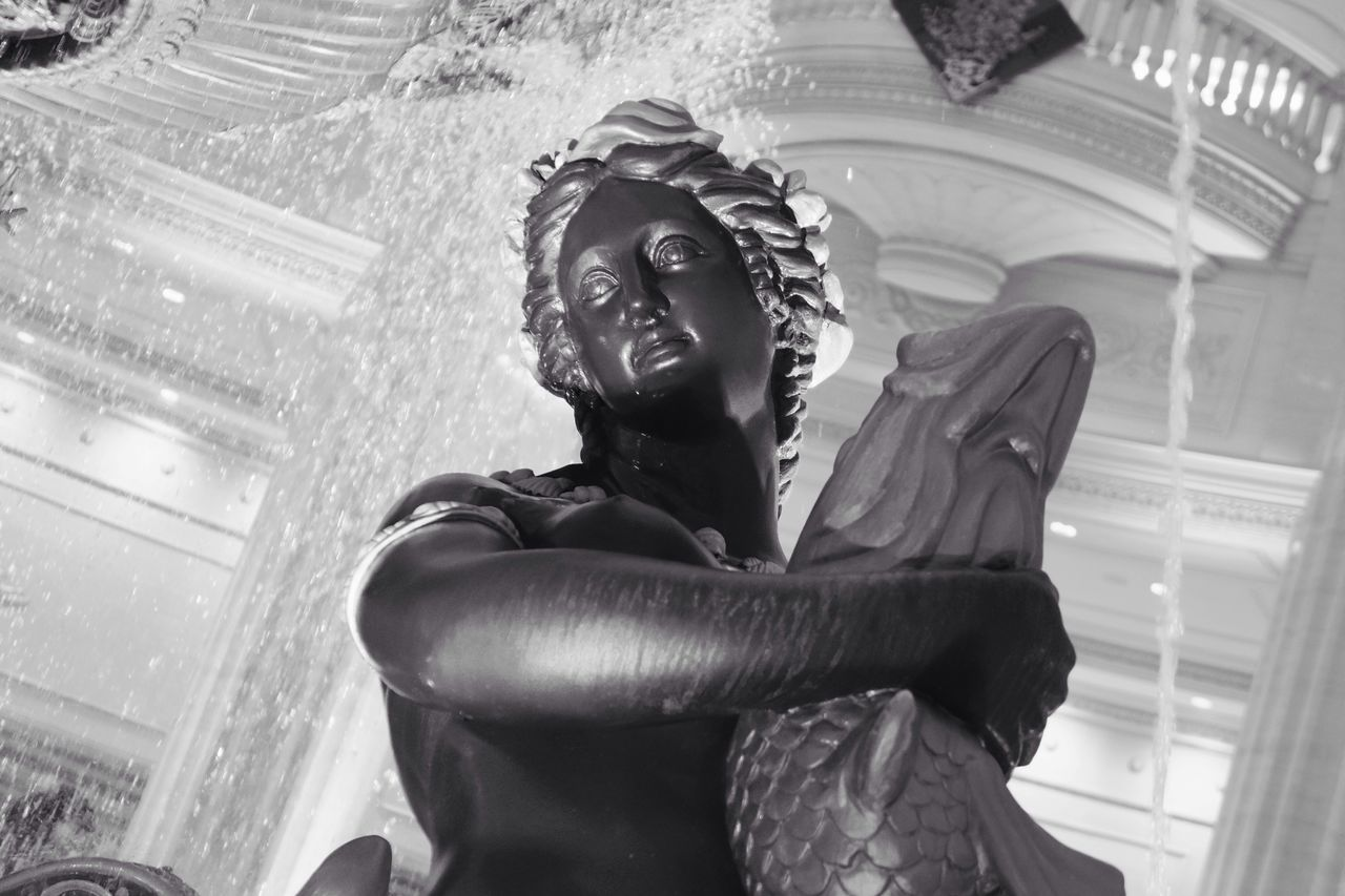 statue, sculpture, low angle view, male likeness, human representation, spirituality, indoors, religion, day, no people