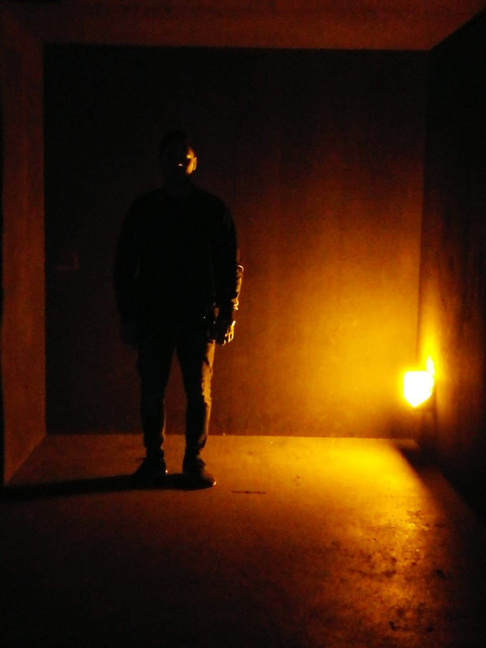silhouette, full length, illuminated, standing, rear view, one person, walking, night, men, indoors, real people, adult, people