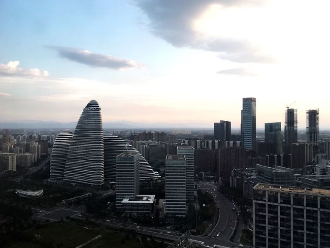 Architecture Horizon Aerial View Skyline City Cityscape Architecture Building Exterior Built Structure Sky Skyscraper Tall - High Dusk Crowded Office Building Modern Tower Cloud Development Cloud - Sky Travel Destinations Growth Building Story Wide Futuristic