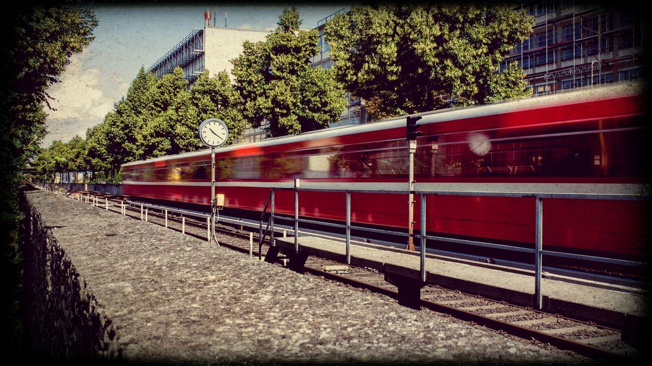 Train Passing Through City