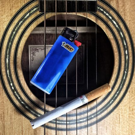 Smoking my lungs While my guitar gently whips its strings!
