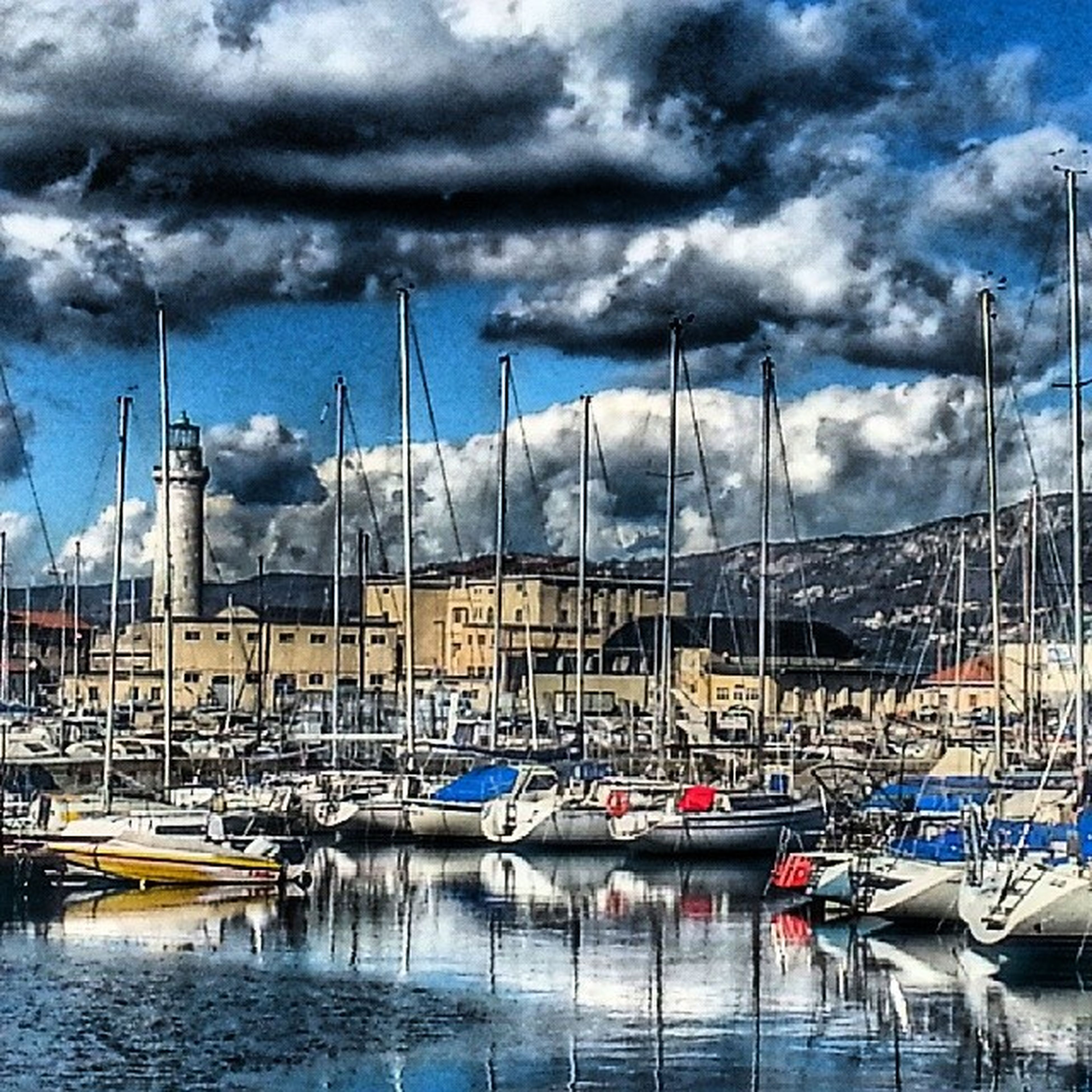 sky, nautical vessel, water, cloud - sky, moored, harbor, transportation, cloudy, waterfront, boat, mode of transport, cloud, mast, built structure, reflection, architecture, sailboat, building exterior, marina, in a row