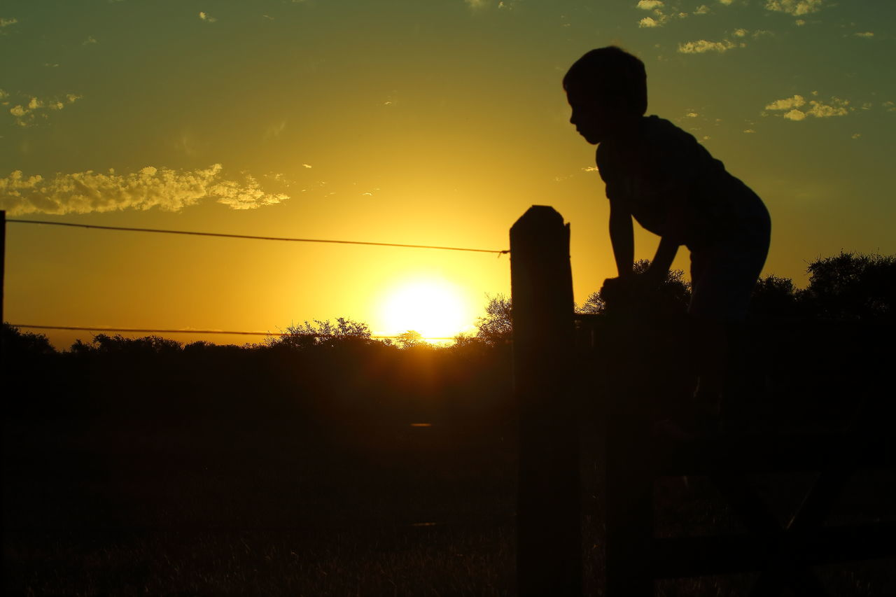 Silhouette One Person Outdoors Day Nature Kid Sunset Fence Wire Rural Sky Sunset