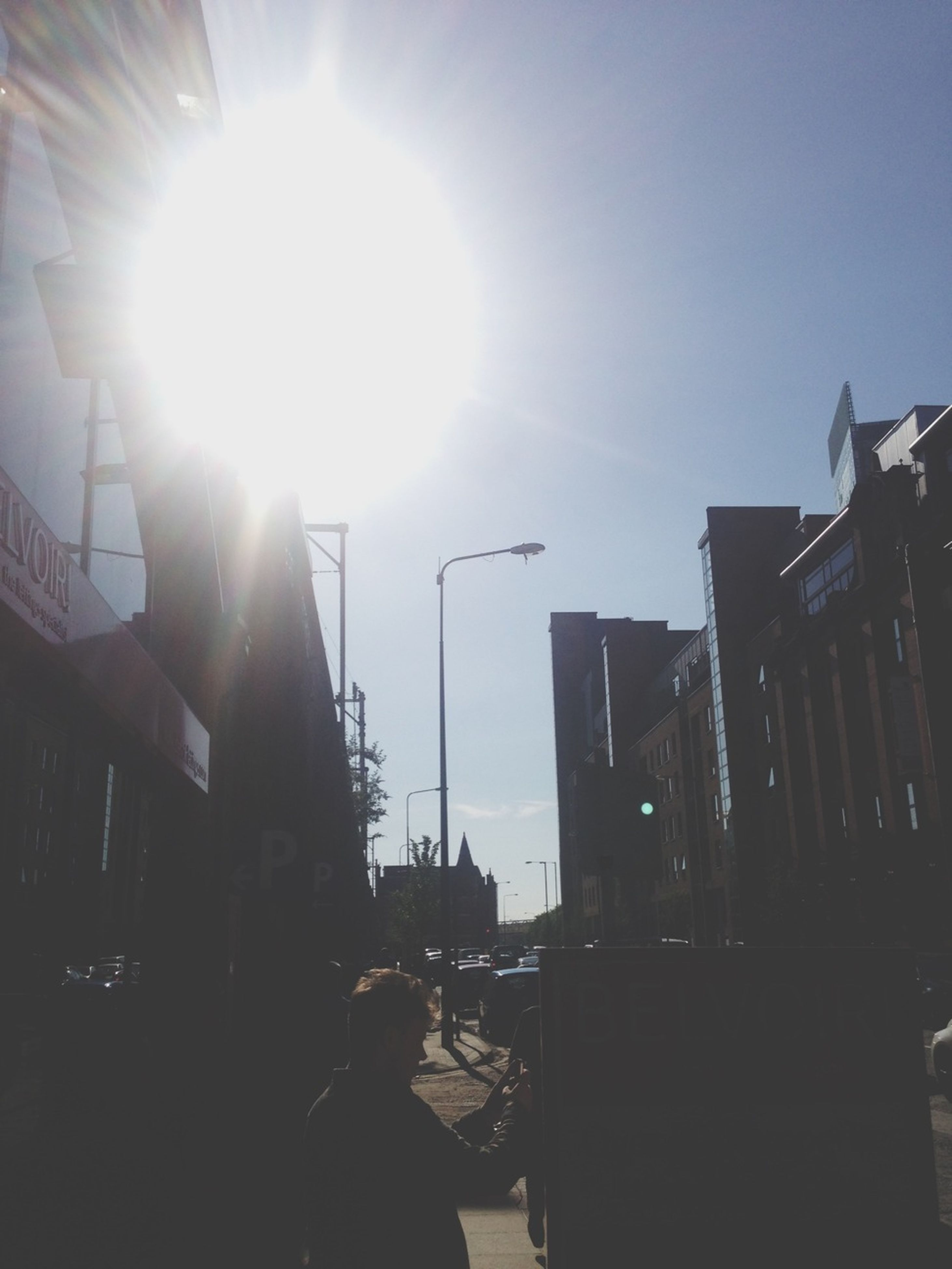 building exterior, architecture, built structure, sun, sunbeam, lens flare, sunlight, clear sky, low angle view, city, sky, building, silhouette, residential building, bright, sunny, residential structure, house, outdoors, day
