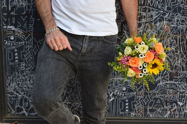 Adult Adults Only Bouquet Fashion Flower Groom Handsome Holding Holding Flowers Human Body Part Low Section Manly  Men Men Style Midsection One Person Outdoors Pattern, Texture, Shape And Form People Perspective Standing Stylish Wall Wedding Wedding Photography