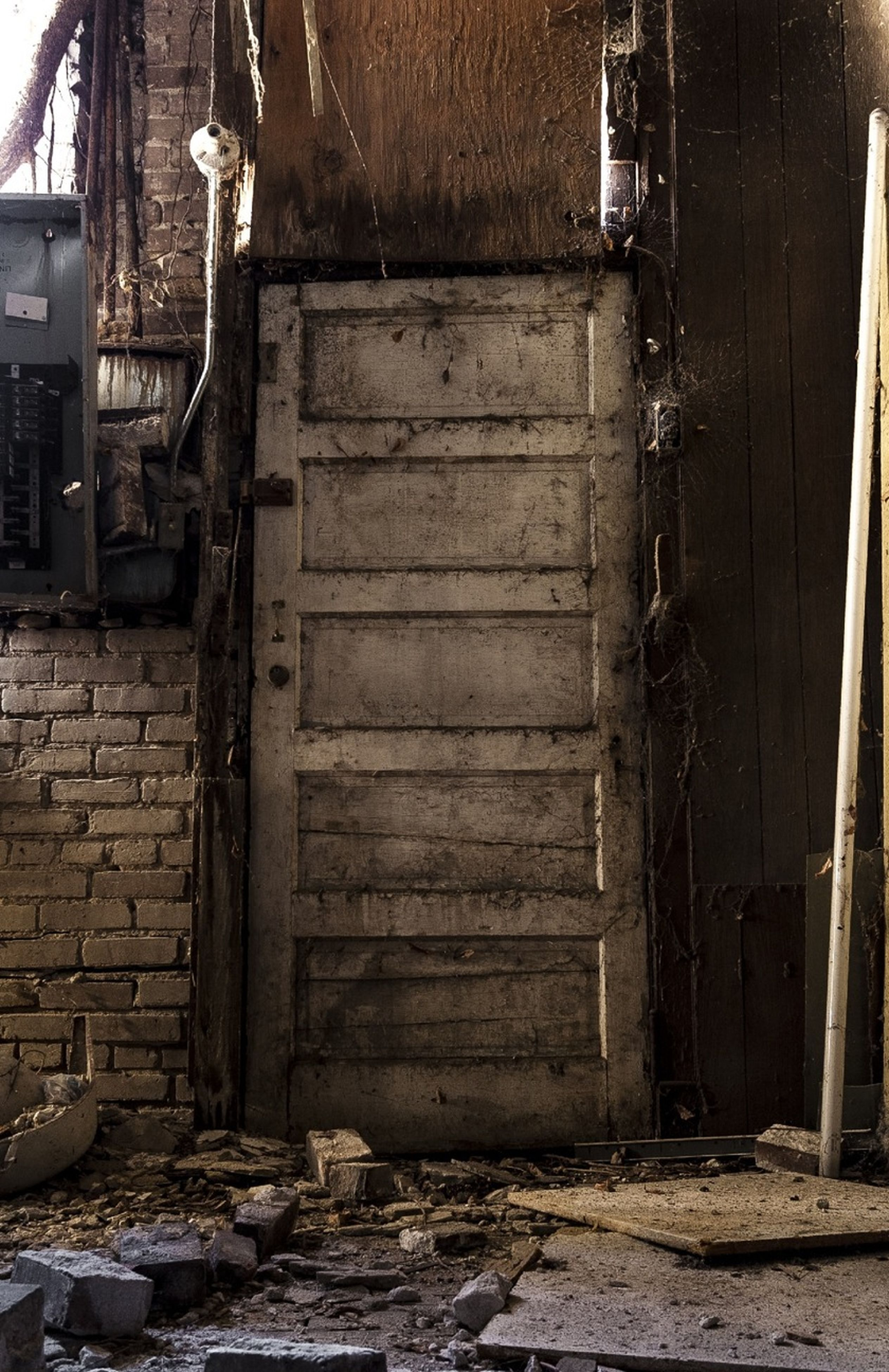 architecture, built structure, building exterior, house, abandoned, old, weathered, damaged, residential structure, obsolete, door, run-down, wall - building feature, building, deterioration, residential building, outdoors, closed, wood - material, day