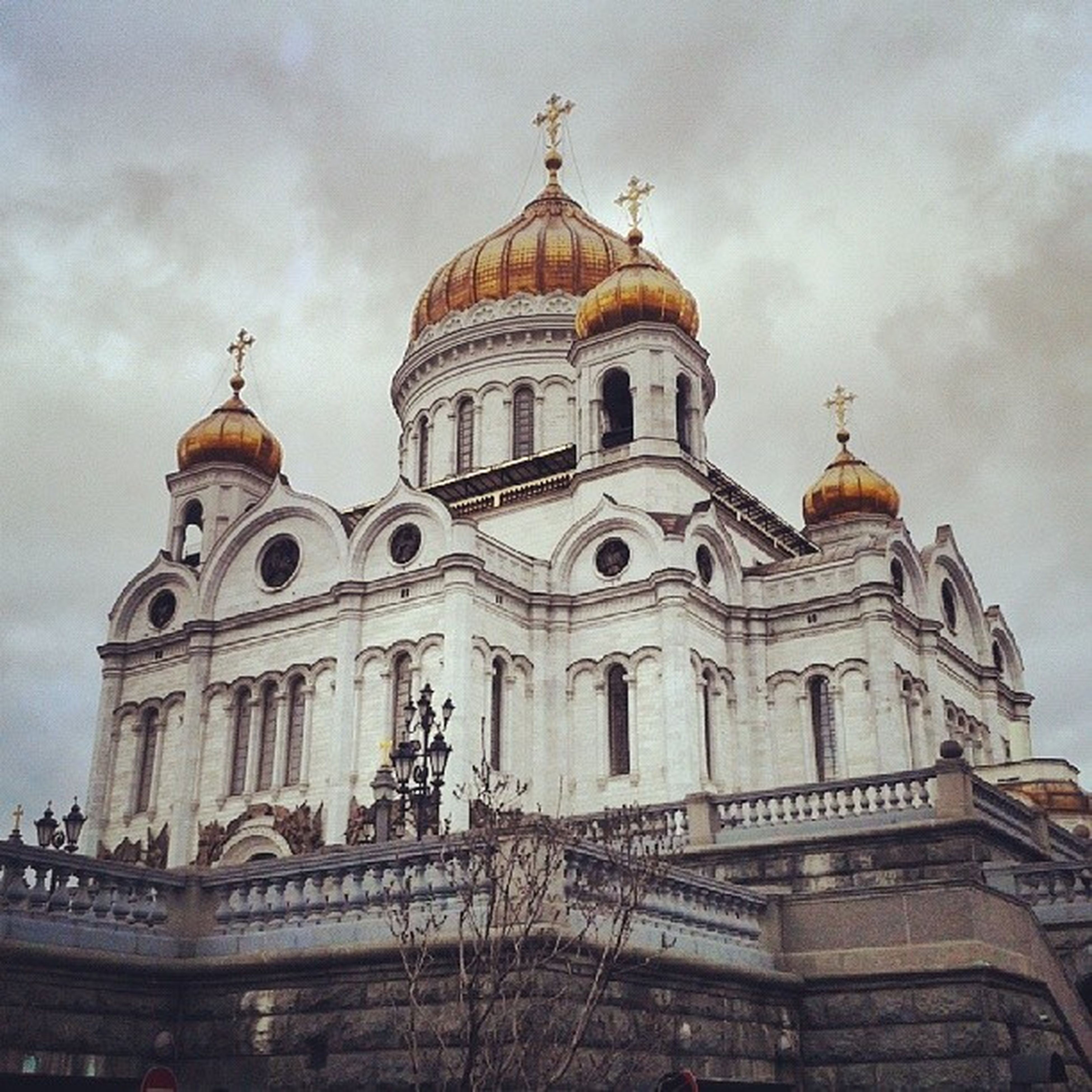 place of worship, religion, spirituality, church, building exterior, sky, architecture, built structure, low angle view, cloud - sky, cathedral, dome, cloudy, cross, cloud, travel destinations, famous place, statue
