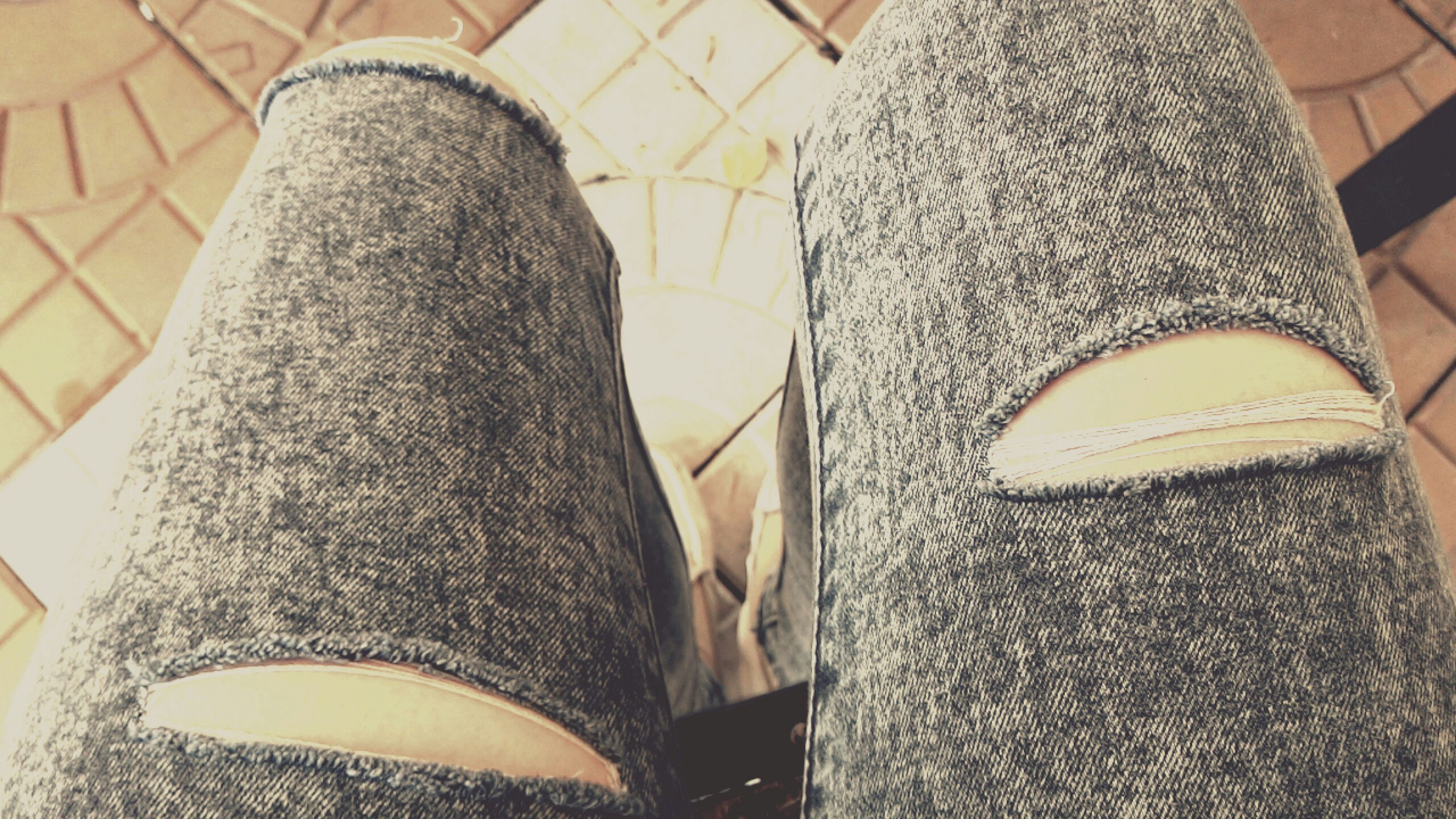 indoors, low section, person, shoe, jeans, fashion, high angle view, close-up, textile, standing, pattern, personal perspective, midsection, footwear, lifestyles, fabric, sunlight