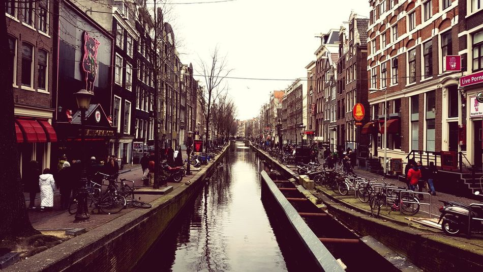 City Street Built Structure Building Exterior Architecture Amsterdam Red Light District Red Light District Street Walking Incidental People Street City Life Citystreet Amsterdamcity Netherlands Cityscape City Outdoors Cityscape Water Cloud - Sky Sky Wet Day People The Street Photographer - 2017 EyeEm Awards EyeEmNewHere