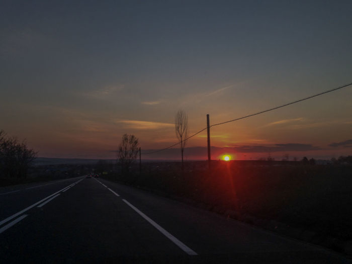 Beauty In Nature Country Road Diminishing Perspective Empty Road Field Landscape Long Nature Non-urban Scene Orange Color Outdoors Power Line  Road Road Marking Rural Scene Scenics Sky Sun Sunrise - Dawn Sunset The Way Forward Tranquil Scene Tranquility Transportation Vanishing Point