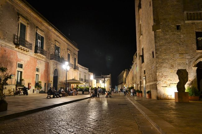 Architecture Building Building Exterior Built Structure City City Life Diminishing Perspective Footpath Historic History Illuminated Italy Night Nightphotography Old Town Outdoors People Person Piazza Puglia Sky Specchia Street Streetphotography The Way Forward