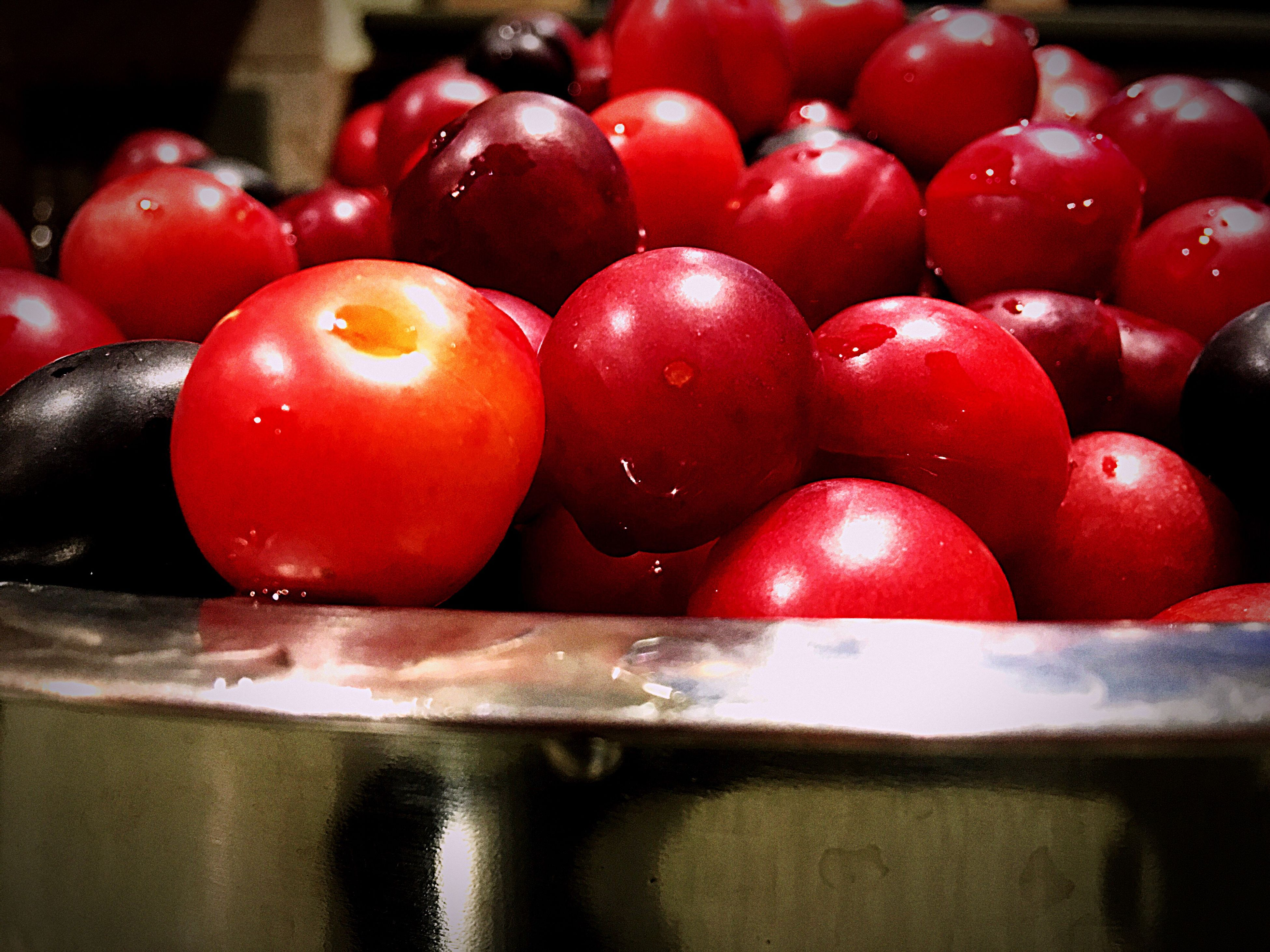 food and drink, red, freshness, food, indoors, fruit, sweet food, healthy eating, dessert, close-up, temptation, ready-to-eat, indulgence, serving size, cherry tomato, water, vibrant color, tray, organic, dessert topping, large group of objects