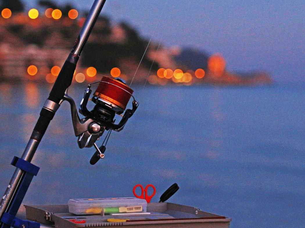 Alassio Alassiobay Blue Hour Close-up Contest Evening Evening Sky Fishing Fishing Contest Fishing Pole Fishing Poles Focus On Foreground Illuminated Lights No People Outdoors Reel Reels Sea Sea And Sky Sky