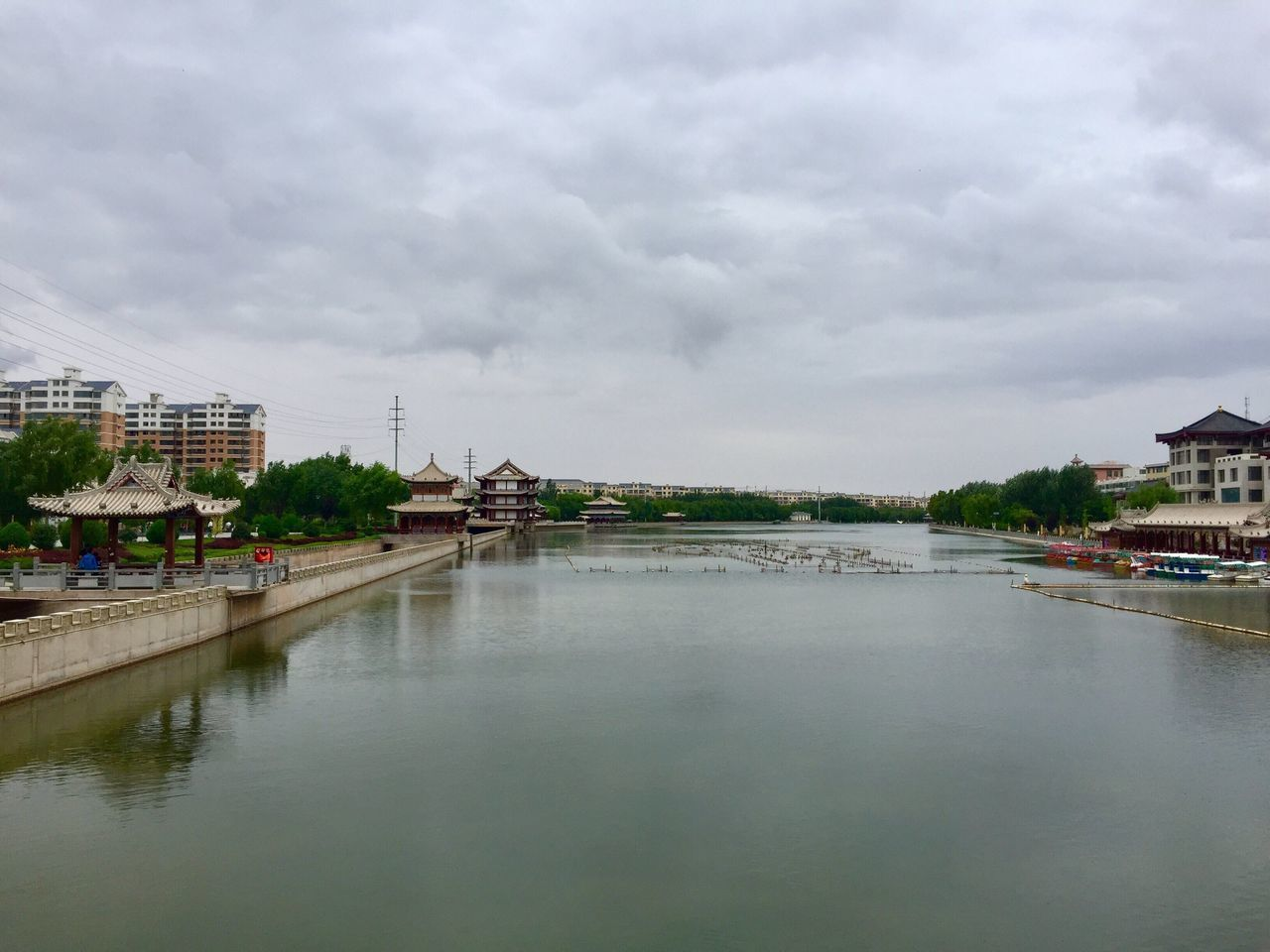 architecture, built structure, water, building exterior, sky, river, cloud - sky, waterfront, day, outdoors, city, no people, town, nature, tree