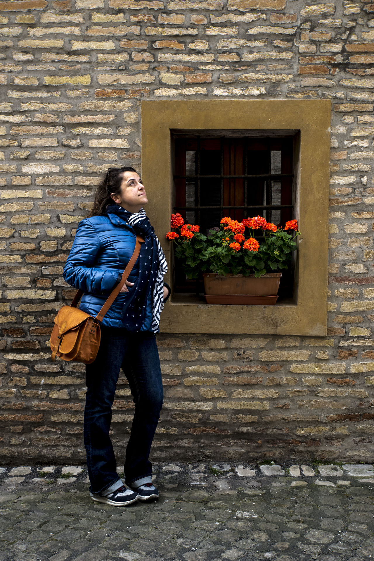 The flowers give beneficial vibrations Brick Wall Bricks Casual Clothing Design Flower Flowers Italy Old Buildings Old Town One Person Portrait Portrait Of A Friend Portrait Of A Woman Portrait Photography Portraits Streetphoto_color Streetphotography Thinking Travel Travel Destinations Travel Photography Walking Around Wall Woman Woman Portrait