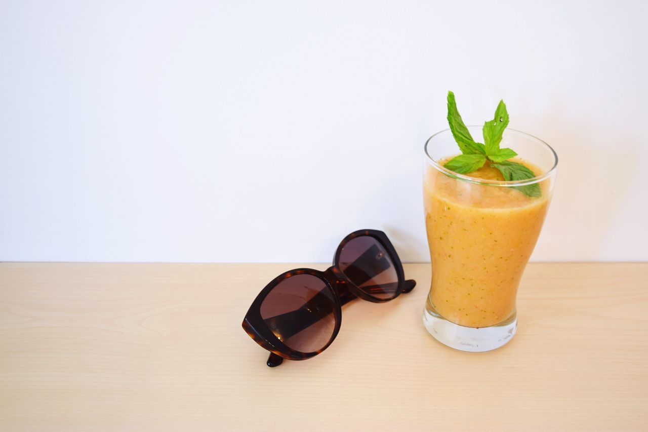 EyeEm Selects Refreshment Drink Summer Fruit Shake Drinking Glass Freshness Healthy Eating Food And Drink Indoors  White Background Studio Shot Ready-to-eat Close-up Table No People Sunglasses Mint Minimalism Yellow Fresh