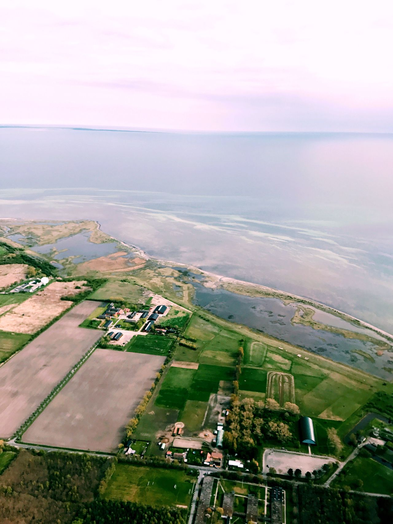 Taking off from Kastrup in Copenhagen. Tranquil Scene Beauty In Nature Scenics Landscape Nature Tranquility Agriculture Rural Scene Aerial View Idyllic Field Sky No People Patchwork Landscape Outdoors Building Exterior Day Built Structure Architecture Water From Above  From A Moving Vehicle Airplane