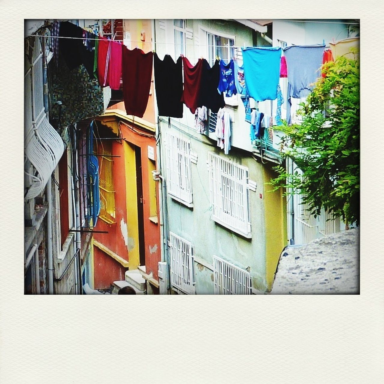 hanging, architecture, clothing, drying, clothesline, built structure, building exterior, no people, day, outdoors, multi colored
