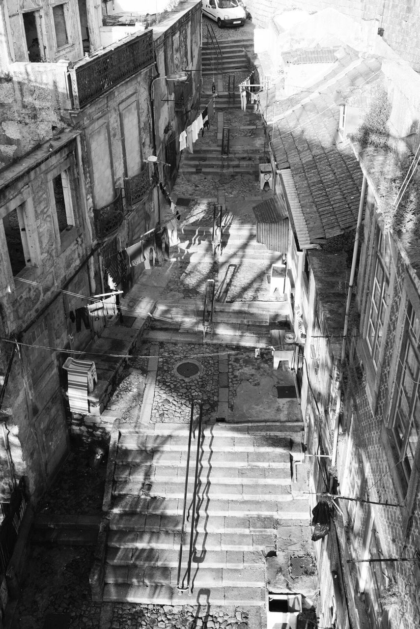 High Angle View Of Empty Steps Amidst Old Buildings