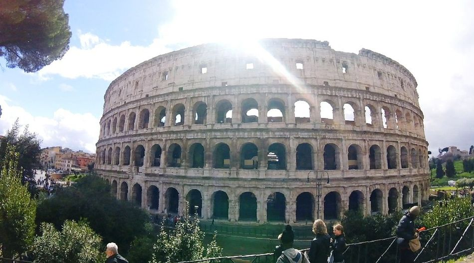 Travel Destinations History Architecture Sky Tourism City Travel Old Ruin Ancient Cloud - Sky Sunbeam Dome People Day Outdoors Building Exterior Built Structure EyeEmNewHere Cold Italy Colesseo Colesseum Roma Destination