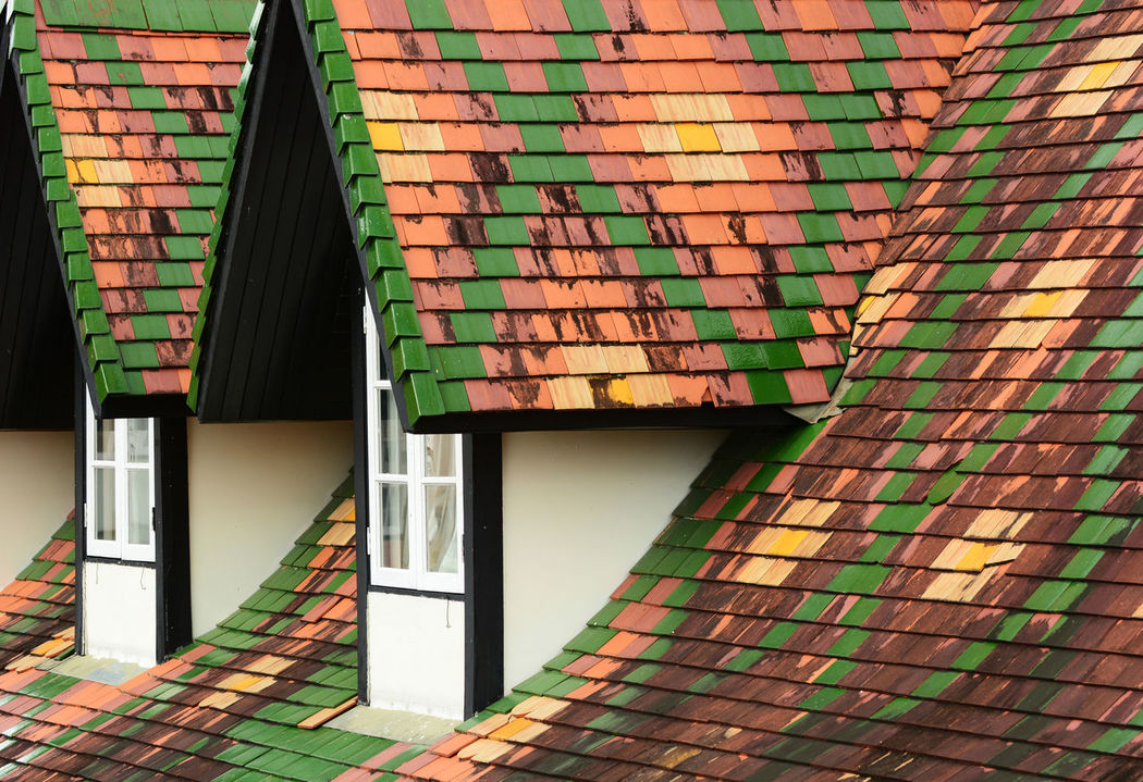 Dormer windows on tiles roof Architecture Backgrounds Building Exterior Built Structure Day Dormer Dormer Windows Dormers Multi Colored No People Pattern Roof Rooftop Tiles Roof