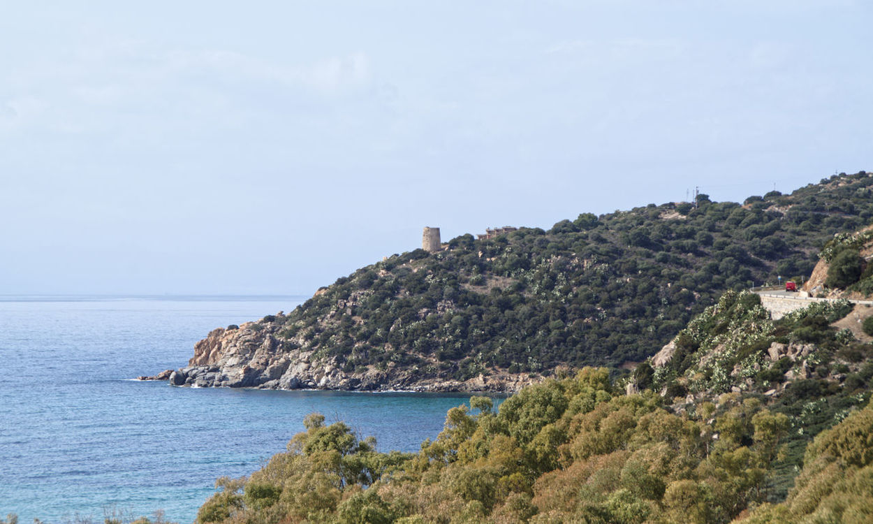 Another bend, another view! This one of a headland disappearing into the sea with an old fortification on the top - probably a lookout post at one time Calm Defensive Structure Fortification Headland Lookout Point Military Structure Promontory Sardinia Sardegna Italy  Sea Vegetation