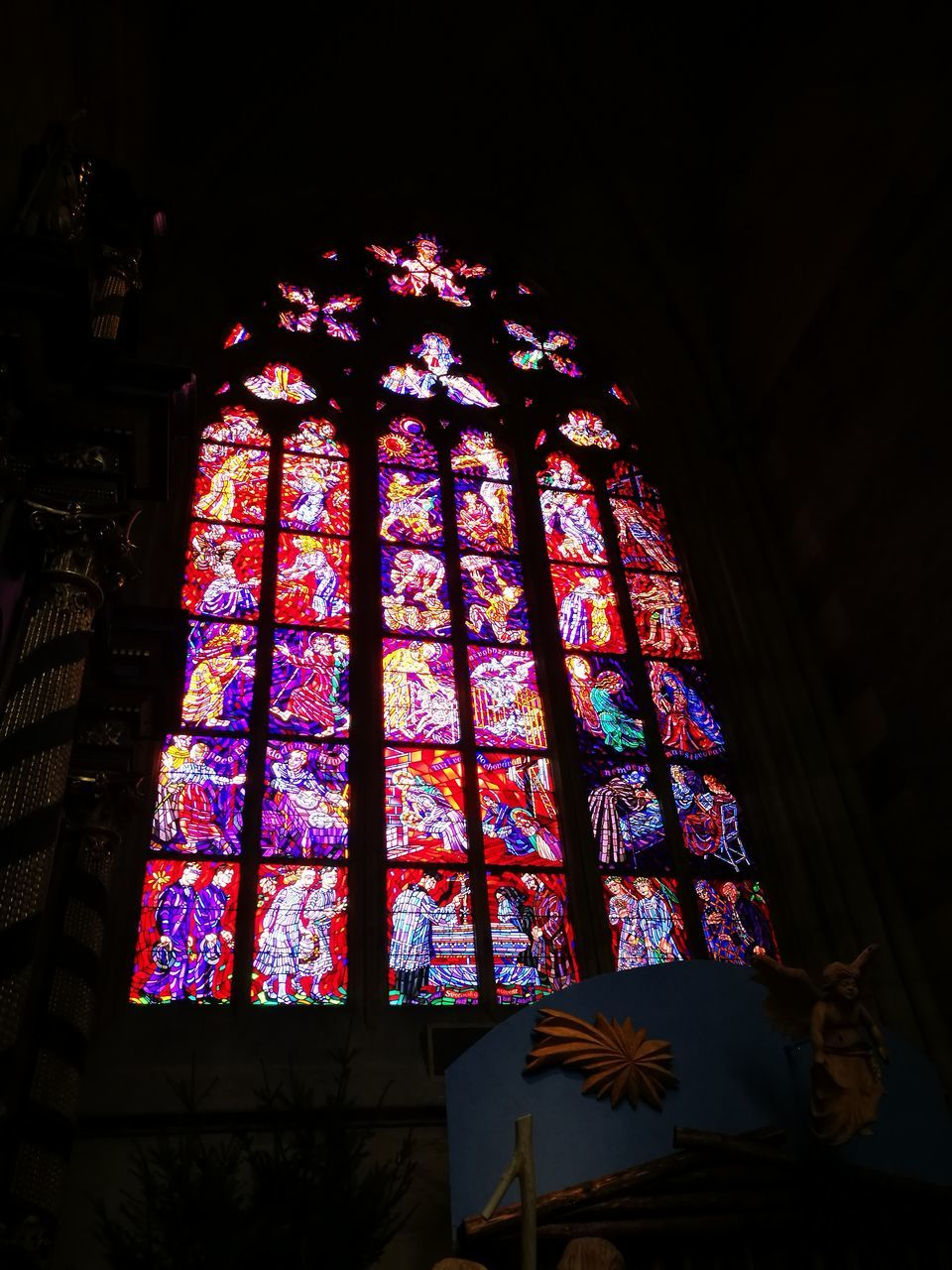 stained glass, place of worship, religion, window, spirituality, indoors, low angle view, architecture, multi colored, built structure, no people, cross, day